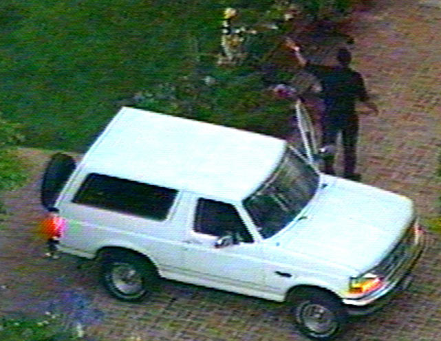 After arriving at Simpson's Brentwood area home, Cowlings walks out of the Bronco.