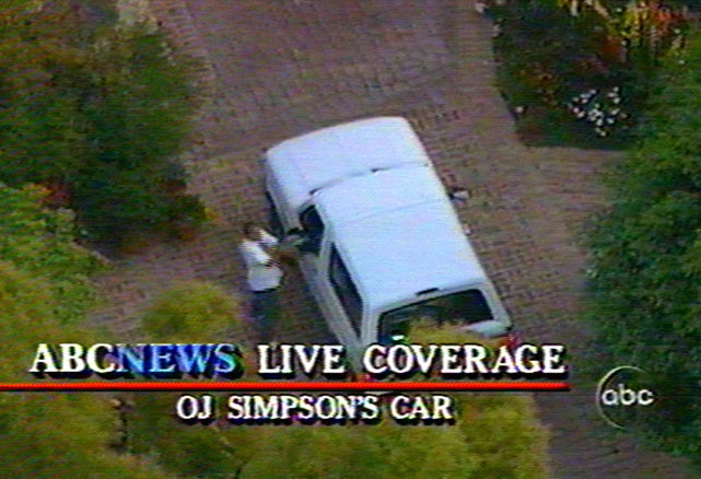 An unidentified man approaches the white Bronco after the car arrives at the driveway of Simpson's Brentwood home.
