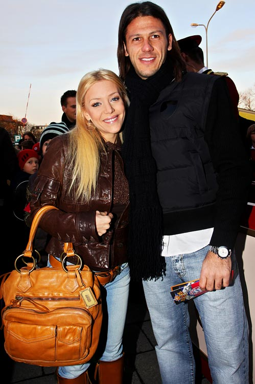 Argentinian midfielder Martin Demichelis (Bayern Munich) and his girlfriend Evangelina Anderson pose as they arrive to attend the FC Bayern Circus Gala at the Circus Krone on December 8, 2008 in Munich, Germany.