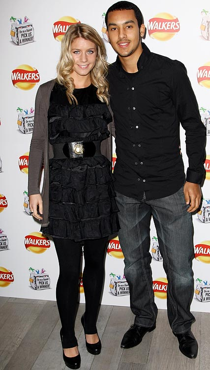Theo Walcott (Arsenal) and girlfriend Melanie Slade attend the 'Do Us A Flavour' Walkers launch party at Paramount, Centre Point building on January 8, 2009 in London.