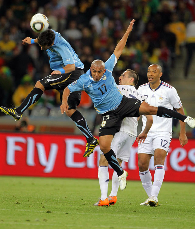 Uruguayan defenders Mauricio Victorino (left) Egidio Arevalo Rios made sure the potent French attack, consisting of Franck Ribery and Thierry Henry, did not get easy chances late in the game.