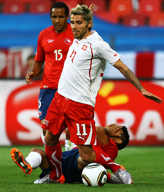 Switzerland was forced to play a man down for the final 60 minutes after Valon Behrami (11) was sent off with a straight red card for rough play.