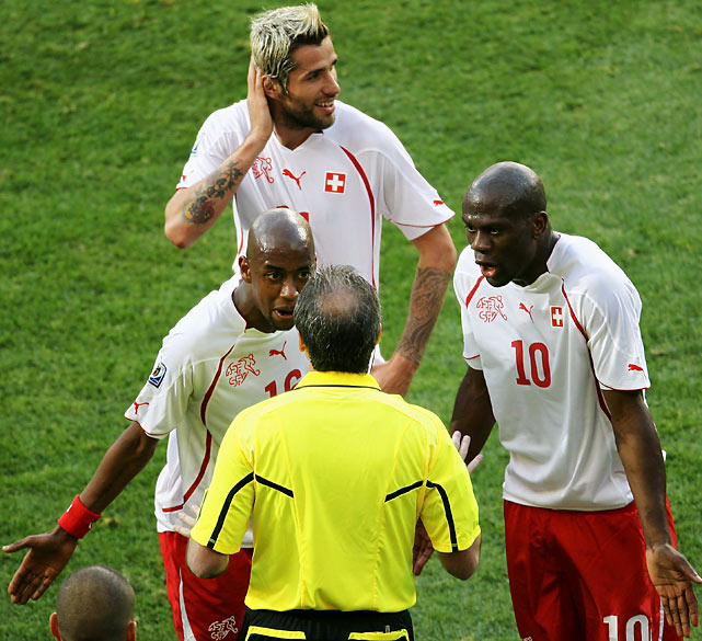 Without Valon Behrami (back), whose ejection was challenged by teammates, the Swiss couldn't hold off Chile's formidable attack in the second half.