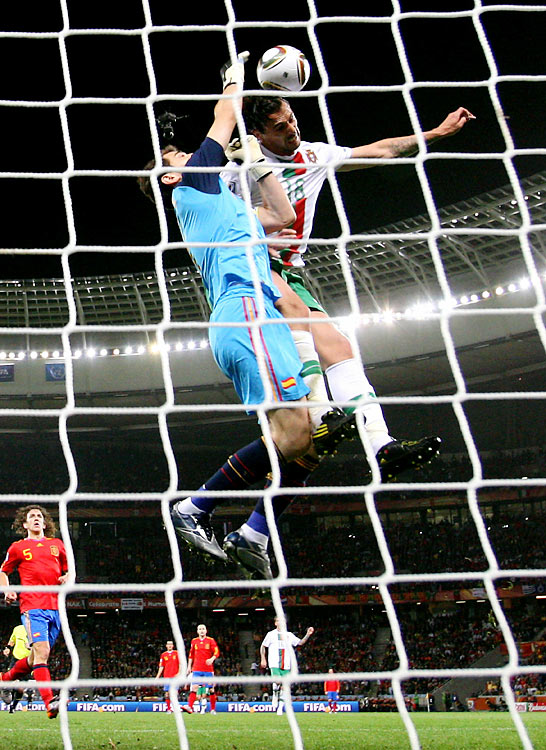 Hugo Almeida had one of Portugal's best chances of the match, just missing connecting on a header off a cross from Raul Meireles while Spain's goalkeeper Iker Casillas attempted to punch the ball away.