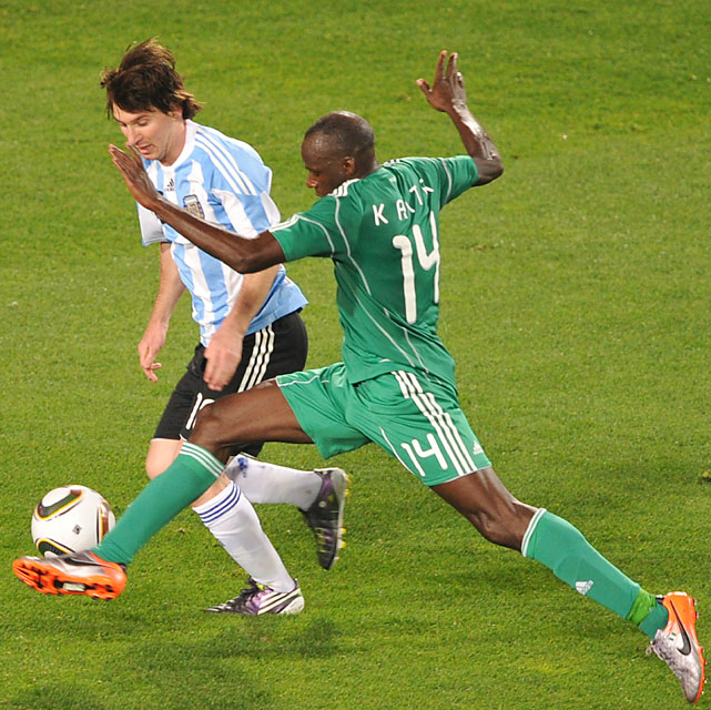 Argentina striker Lionel Messi (left) vies for a loose ball with Nigeria midfielder Sani Kaita.
