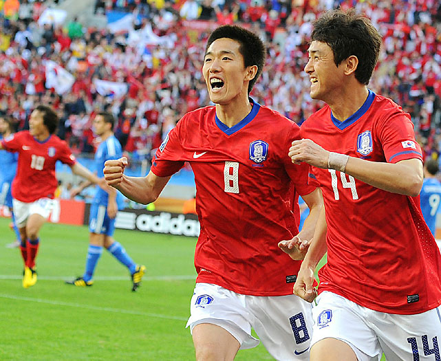 South Korea defender Lee Jung-Soo (right) celebrates with midfielder Kim Jung-Woo after scoring to give South Korea a 1-0 lead.