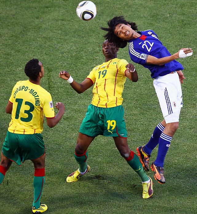 Yuji Nakazawa (right) is challenged by Stephane Mbia (center) and Eric Choupo Moting of Cameroon, which didn't get a shot on goal until the 37th minute and was unlucky in the 87th minute when Stephane Mbia's long shot hit the left post.