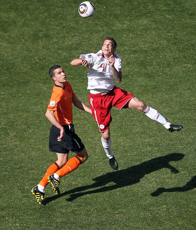 Daniel Agger (right) and the Denmark defense kept a powerful Netherlands attack in check for most of the game.