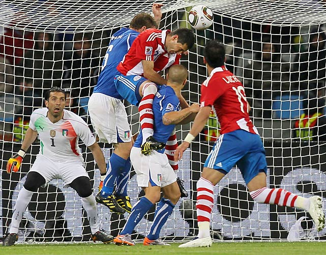 Paraguay defender Antolin Alcaraz (center, in red jersey) scored on a header in the 39th minute to give the underdogs a first-half lead against defending champion Italy in rainy Cape Town. Alcraz beat venerable Italian goalkeeper Gianluigi Buffon, who was lifted at halftime because of an apparent back injury.