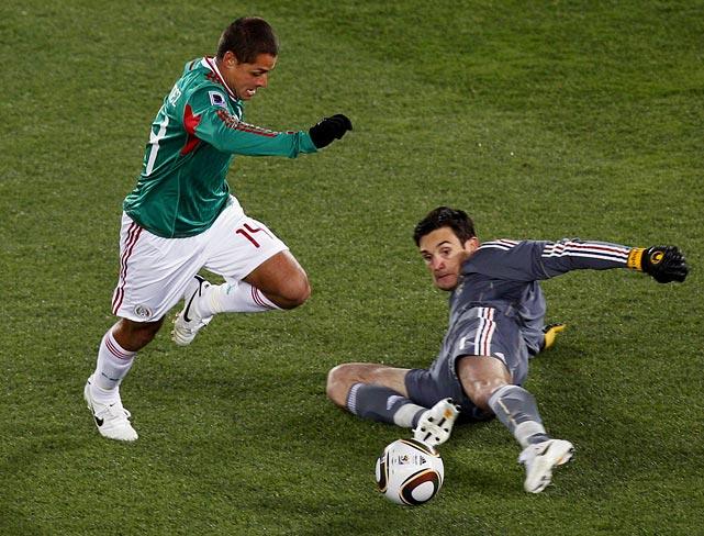 Substitute Javier Hernandez dribbled around French goalkeeper Hugo Lloris to break the scoreless tie in the 64th minute.
