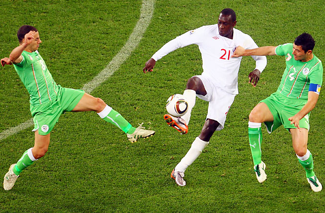 All day, England had difficulties getting the ball to its forward Emile Heskey (21). In the first half, Heskey had only one touch in the box. And when he did touch the ball, he was swarmed by Algerian defenders.