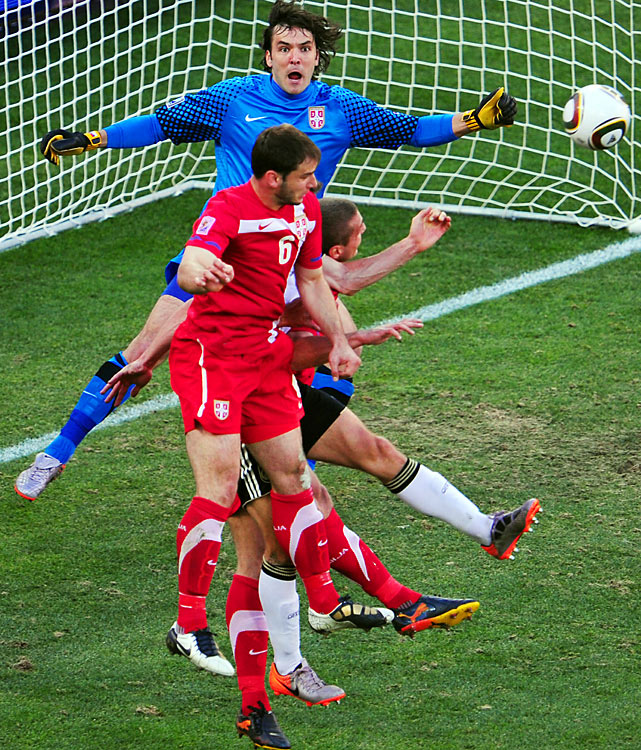 Serbia goalkeeper Vladimir Stojkovic (back) made saves on both of the shots he faced in the match. When Serbia pulled off the upset, Stojkovic grabbed the ball and stuck it in his jersey.