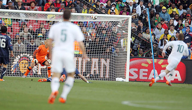 Given the space to create by Oguchi Onewu, Slovenian striker Valter Birsa (10) lets loose a left footed strike from well outside the area. Tim Howard watches helplessly as the ball floats into the back of the net to put Slovenia ahead 1-0.