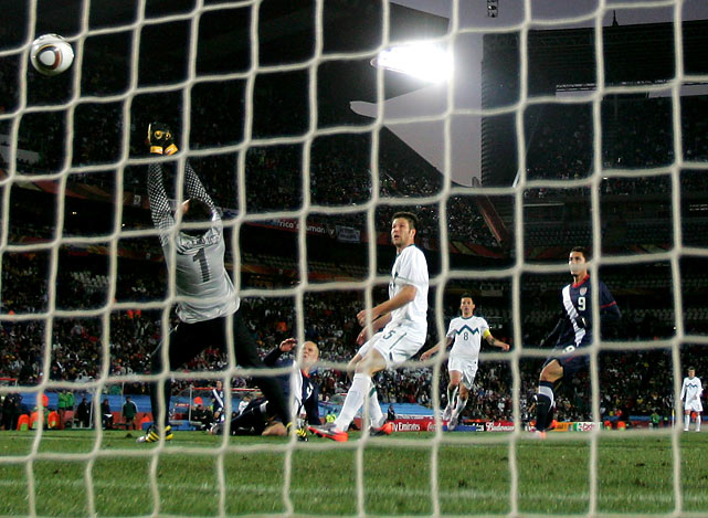 Bradley's equalizing goal sails over the outstretched arms of Samir Handanovic as Bostjan Cesar looks on.