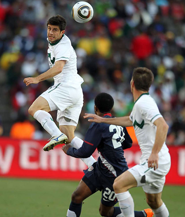 Bojan Jokic elevates over Robbie Findley (20) to play a header during the World Cup match-up between Slovenia and the USA.