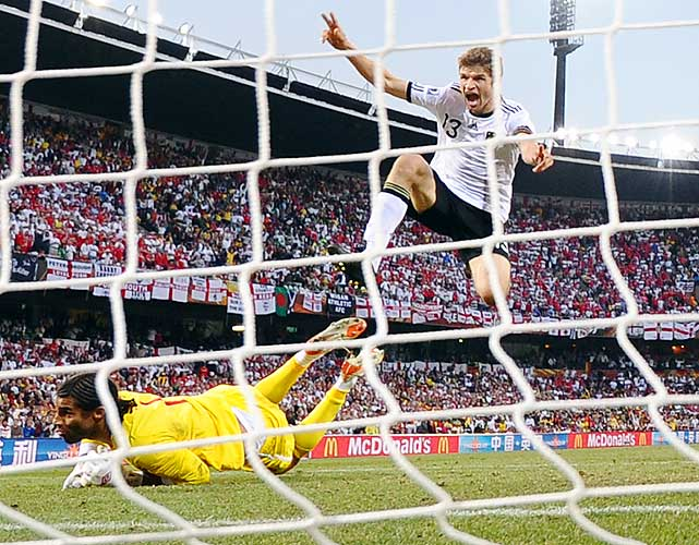 Germany's Thomas Mueller scores Germany's third goal. Mueller beat James twice, making dazzling runs from the midfield all match.