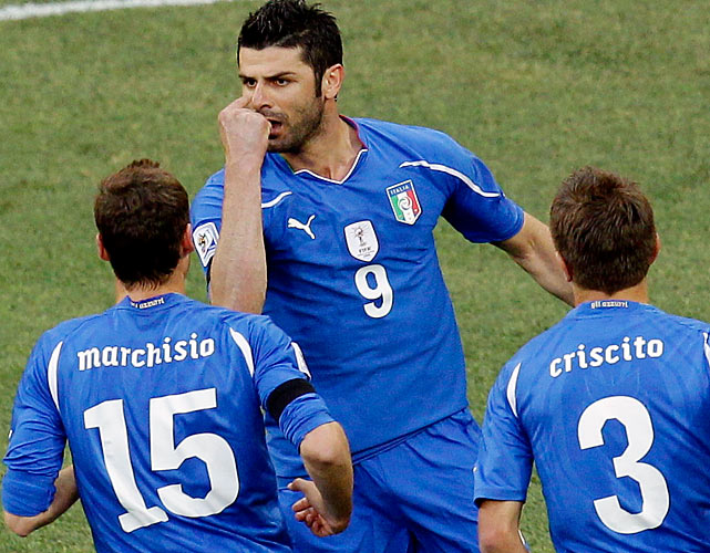 Italy's Vincenzo Iaquinta, top, celebrates after scoring a penalty against New Zealand. The Italians earned a second straight draw.