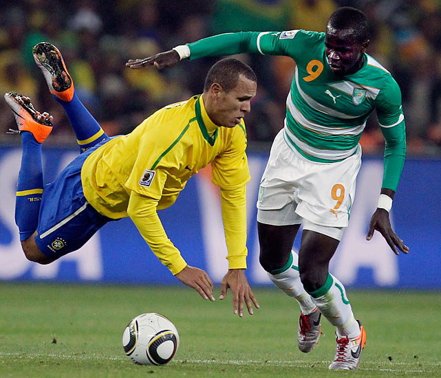 Brazil striker Luis Fabiano vies for the ball with Ivory Coast's Cheick Tiote. Fabiano ended an international scoring drought with two goals.