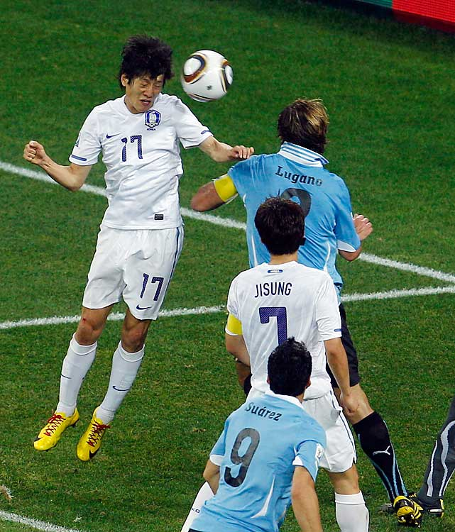 South Korea's Lee Chung-yong, left, scores South Korea's lone goal past Uruguay's Diego Lugano.