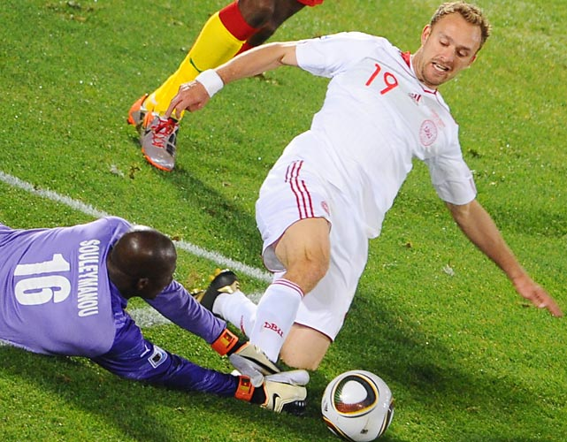 Denmark's Dennis Rommedahl tries to punch a shot past Cameroon goalkeeper Hamidou Souleymanou. Rommedahl scored one of the Danes' two goals.