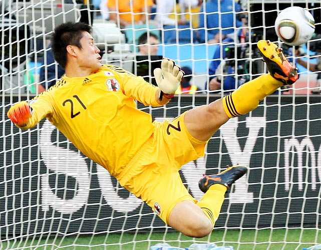 Japanese goalkeeper Eiji Kawashima makes a futile attempt to stop Wesley Sneijder's shot in the second half. It's the only goal Kawashima has allowed in the World Cup so far.
