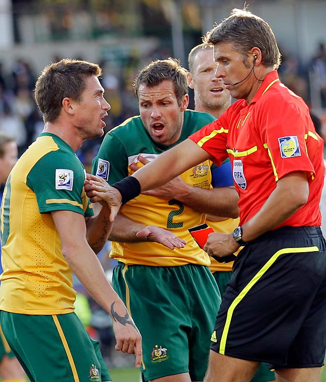 Australia's Harry Kewell (left) argues with referee Roberto Rosetti after a handball that resulted in a red card and a Ghana penalty kick.