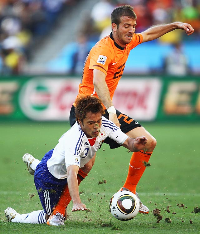 The Netherlands' Rafael van der Vaart tries runs past Japan's Yuichi Komano. The Dutch became the first team to advance to the knockout round.