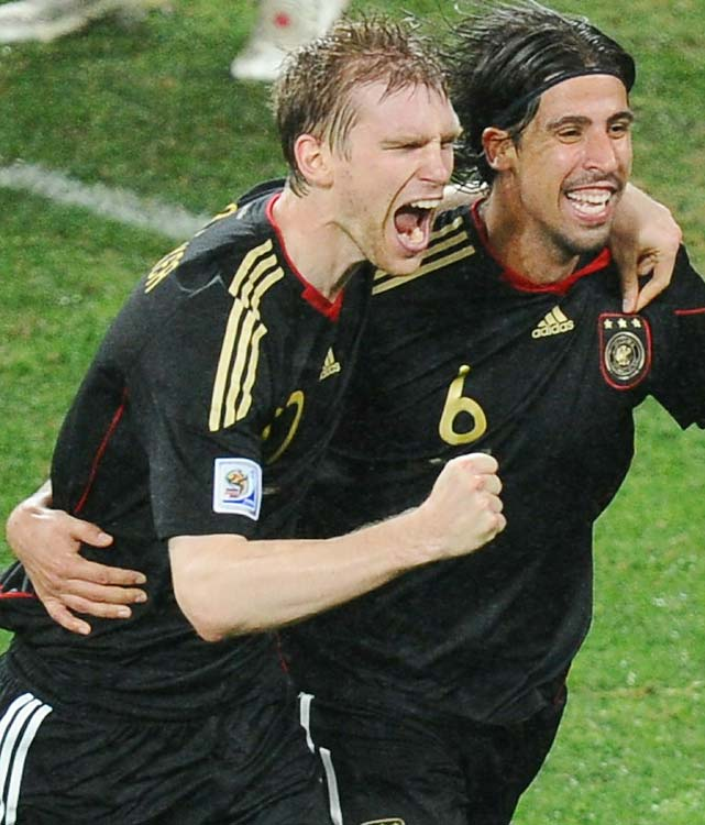 German defender Per Mertesacker celebrates with goal scorer Sami Khedira. Mertesacker was playing his second World Cup, while Khedira, in his first, was a big part of Germany's youth movement.