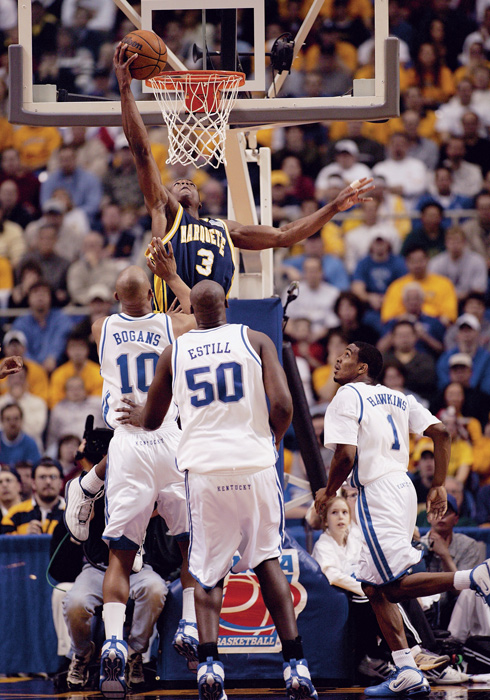 At the  2003 NCAA Tournament, Wade recorded a triple-double (29 points, 11 rebounds and 11 assists) in a victory over top-seeded Kentucky.