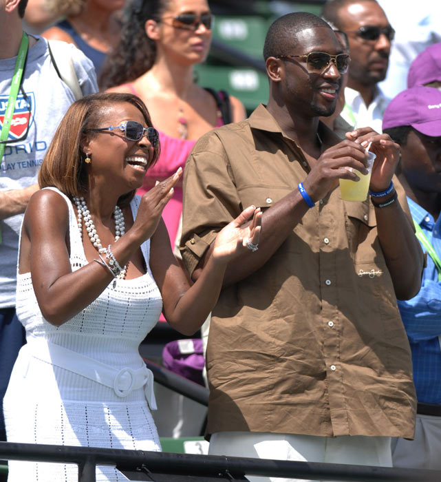 Wade Jr. and Star Jones Reynolds watch Serena Williams battle Justine Henin at the Sony Ericsson Open women's final.