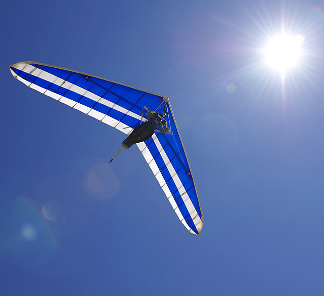 Each summer, 80 to 125 pilots venture to Idaho to compete in the King Mountain Hang Gliding championships. SI photographer David E. Klutho was at the 2010 contest from July 19 to July 24. Here are some of his best shots from the event.  L.J. O'Mara, who was part of the recreation class, glides beneath a glistening sun on the afternoon of July 20.