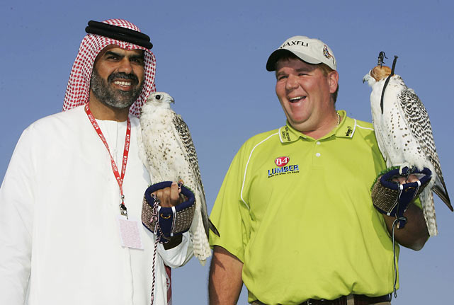 Daly participates in a falcon show while promoting the Abu Dhabi Golf Championship in the United Arab Emirates.