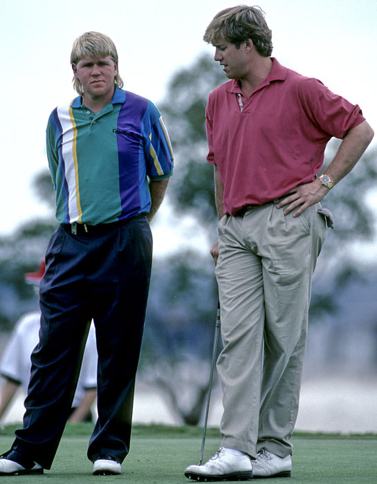Daly and John Elway share the first tee while playing in Dan Marino's golf tournament.