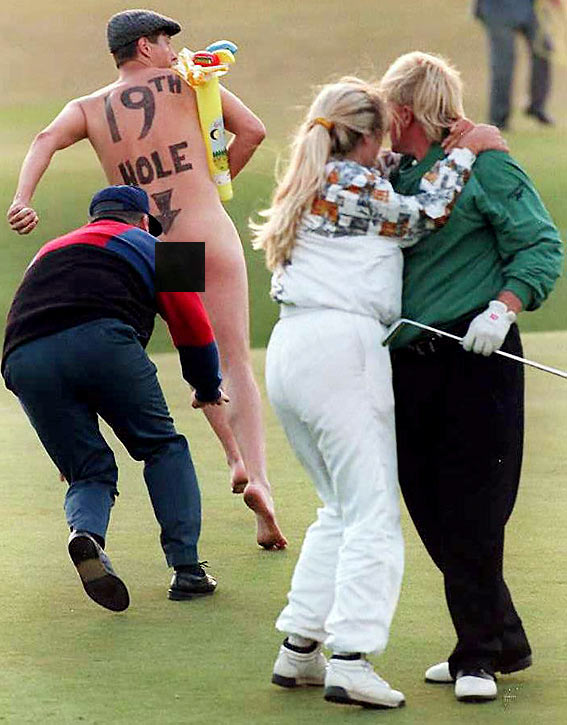 A streaker interrupts as Daly and then-wife Paulette celebrate his win at the British Open.