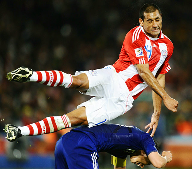 Paraguay defender Paulo da Silva jumps over Japan midfielder Makoto Hasebe during their Round of 16 matchup at the World Cup on June 29 in Pretoria, South Africa. Paraguay won a penalty shootout 5-3 to advance to the quarterfinals.