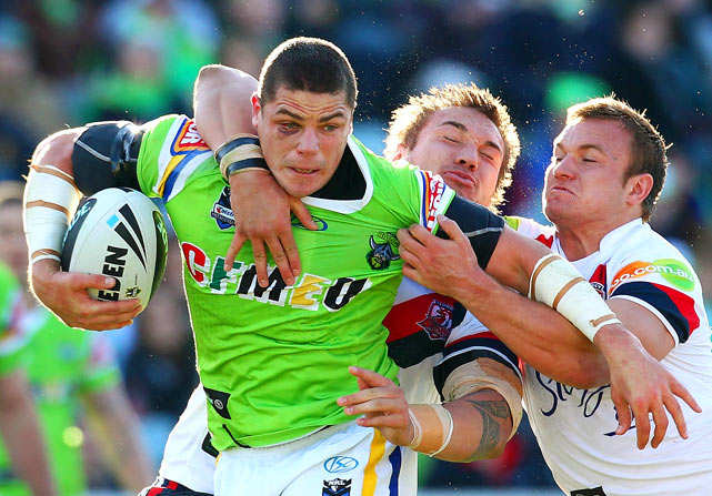 Canberra's Trevor Thurling is tackled during their NRL Round 17 matchup with the Sydney Roosters on July 4 in Canberra, Australia. The Roosters won 22-12.