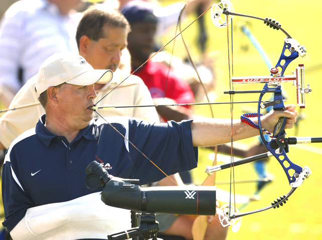 Jerry Shields, 54, from Jacksonville, Fla., an Army and National Guard veteran, pulls the string of his compound bow with his mouth on his way to winning the gold medal in the quadriplegic masters archery event July 9 in Denver. Shields, who suffered a stroke in 1997, also competed in air guns and power soccer at the 30th National Veterans Wheelchair Games.