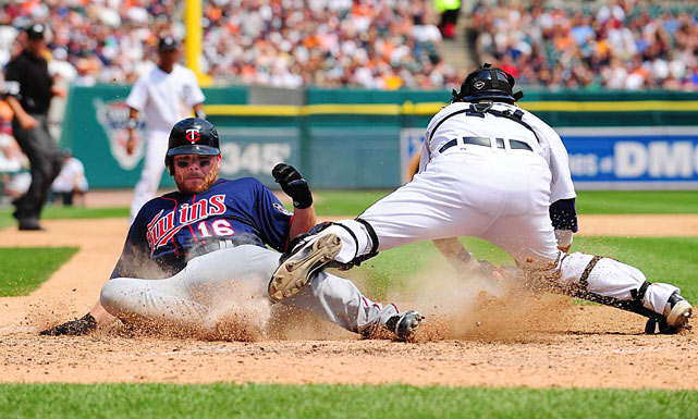 Jason Kubel of the Twins beats the tag by Alex Avila during Minnesota's 6-3 victory.