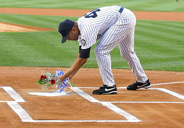 Relief pitcher Mariano Rivera places flowers at home plate in memory of George M. Steinbrenner III before the Yankees played the Tampa Bay Rays at Yankee Stadium on July 16. The New York Yankees honored Steinbrenner and Bob Sheppard on the field before the game.