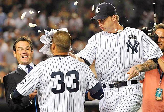 New York Yankees pitcher A.J. Burnett hits Nick Swisher with a pie in the face after Swisher drove in the winning run in the ninth inning of their home game against the Tampa Bay Rays on  July 16.
