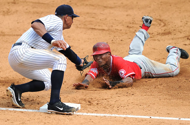 Los Angeles  Angels of Anaheim base runner Erick Aybar is tagged out by  Yankees third baseman Alex Rodriguez while trying to steal third in a 10-6 loss in New York.