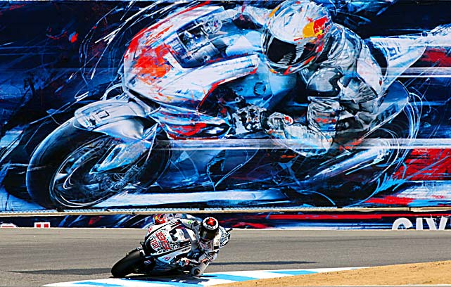 Jorge Lorenzo mirrors the mural on the wall during a practice run for the Red Bull U.S. Grand Prix in Monterey, California.