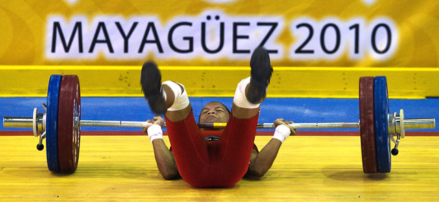 Russmery Villar of Colombia fails in her attempt during the women's 53kg weightlifting final at the XXI Central American & Caribbean Games in Mayaguez, Puerto Rico.