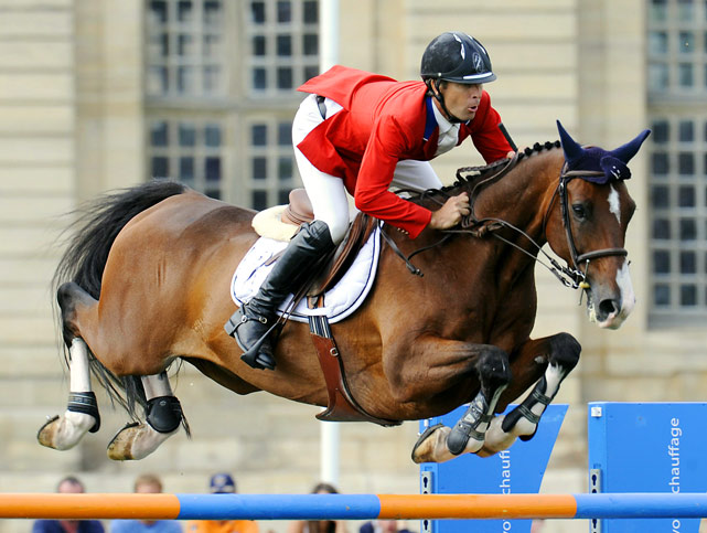 Richard Spooner of the U.S. jumps an obstacle on Cristallo during the International Chantilly Show Jumping in Chantilly, northeastern Paris. Spooner finished 10th.