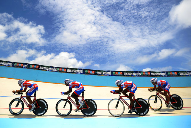 Dominican cyclists Norlandy Tavera, Rafael Meran, Augusto Sanchez and Wilmi Gil compete in the 4000-meter team pursuit  in Aguadilla, Puerto Rico during the XXI Central American & Caribbean Games.