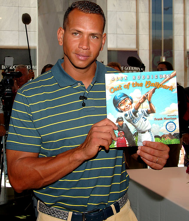 Rodriguez holds up his children's book, <italics>Out of the Ballpark</italics>, at a book signing in July 2007.