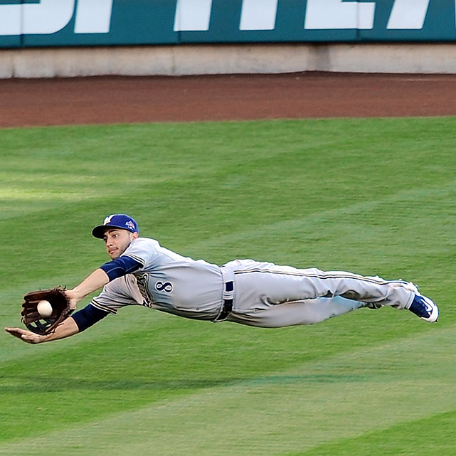 Milwaukee Brewers left fielder Ryan Braun went 0-for-2 at the plate before being pulled, but he contributed defensively with a diving grab to rob Texas Rangers outfielder Josh Hamilton in the fourth.