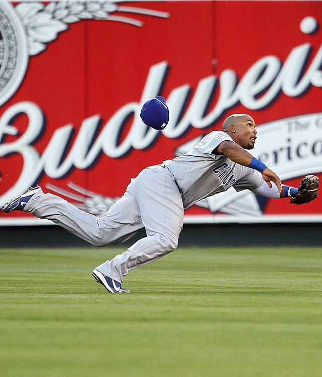 Chicago Cubs outfielder Marlon Byrd dived -- and missed -- trying to catch a bloop fly from Derek Jeter in the sixth. Roy Halladay an the NL escaped the inning thanks in part to a strikeout (Paul Konerko)-throw out (Elvis Andrus) double play to remain down 1-0.