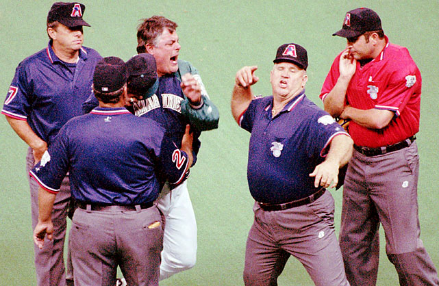 "Edgar Martinez's apparent home run was changed to a double and ""Sweet"" Lou went sour. It took the entire umpiring crew to pacify Piniella enough to get him off the field after this 1996 ejection in Seattle."