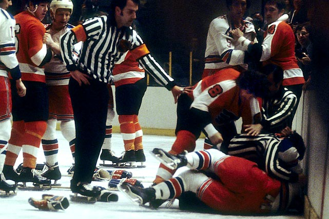 """The Broad Street Bullies were the first hockey team to use intimidation as a tactic. Urged by coach Fred Shero to """"take the shortest route to the puck carrier and arrive in ill humor,"""" rugged enforcers like Dave (The Hammer) Schultz, Bob (Hound) Kelly, Don (Big Bird) Saleski and Andre (Moose) Dupont racked up penalty minutes in record quantities while clearing the way for skill players like Reggie Leach, Bill Barber and three-time NHL MVP Bobby Clarke."""